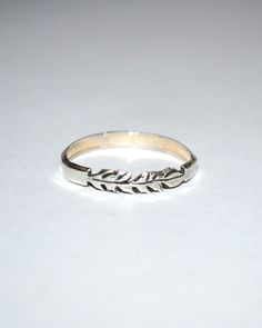 The Silver Larger Breed Feather Ring by JewelMint.com, $36.00