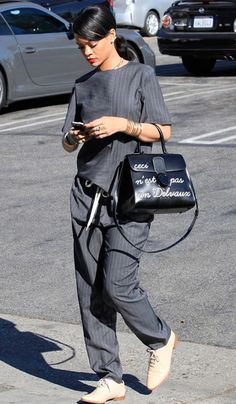 Rihanna in pinstriped grey pajama ensemble + doctor bag + masculine lace-up shoes #streetstyle fashion.