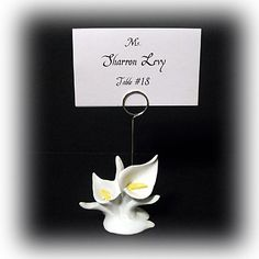 """Calla Lily Placecard Holder  Made of Poly Resin, this Calla Lily Placecard Holder will be a beautiful addition to any party or reception. It measures approx.: 4"""" H x 2 1/4"""" W from top of holder to the bottom. #wedding #favors #calla #lily #placecard"""