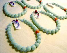 Felted bead necklaces.  I love the single orange bead.