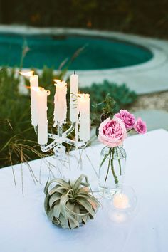 dripping candles + simple floral arrangements