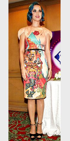KATY PERRY  To open the Indian Premier League cricket tournament in Chennai, India, the singer selects a sequined, printed Manish Arora sheath with rosy chandeliers and killer ankle-strap wedges.