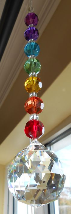 Rainbows:  Chakra Crystals., I have one just like this, hanging for my window, just gorgeous when the sun shines on it...<3