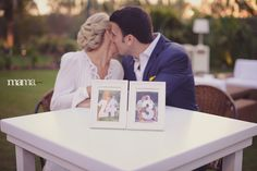 Love that the table numbers are photos of the bride and groom holding huge numbers.