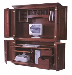 Amish Deluxe Computer Desk Armoire This Deluxe Desk Armoire works hard and tucks away your work items behind beautiful raised panel bi fold doors. Built in choice of solid wood, stain and hardware. American made. #desks #computerdesk