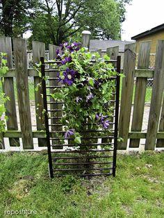 from Kim @Reposhture; repurpose crib sides into clematis trellis