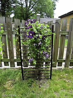 repurpose crib sides into clematis trellis