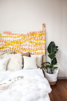 This DIY headboard project only looks like it requires an advanced degree in weaving. (Surprise: It's actually easy enough for beginners to make.)