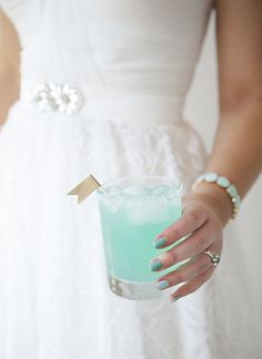 1 oz Malibucoconut rum 1 oz Blue Curacao liqueur Sprite soda pineapple juice Decided Vodka, Lemonade & Blue Curacao.