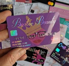 Purple plastic business cards with the Barbie Beauty Logo in the background. Holographic foil and embossed numbers make this look and feel like a real credit card. # credit card business card design Credit card business cards on plastic for Cute Business Cards, Plastic Business Cards, Beauty Business Cards, Salon Business Cards, Business Card Design, Credit Card Design, Diy Lip Gloss, Bussiness Card, Holographic Foil