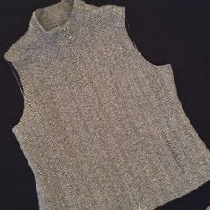 Wool Herringbone Lined Vest Coldwater Creek, like new, fitted, lined, wool herringbone vest. Side pockets, zip front. 80% wool, 20% nylon. All the rage, yet won't go out of style. Like new. Size 14, soft black and light gray herringbone fabric. Coldwater Creek Jackets & Coats Vests