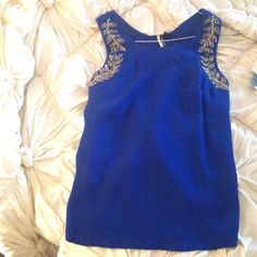 Topshop cobalt blue backless top with beading Absolutely LOVE this top! Unfortunately small on me, as topshop runs a bit small. The beaded detailing on this top is stunning. Keyhole back adds drama. US size 6. Perfect condition, like-new without tags. Topshop Tops