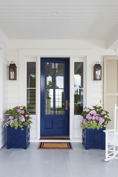 Historic Charm in a New Florida River House – Blue and White Home love that the planters match the front door, looks more modern and pretty White Exterior Houses, White Houses, House Front Door, House Doors, Garage Doors, Front Porch Planters, Porch Doors, Entry Doors, Exterior Paint Colors