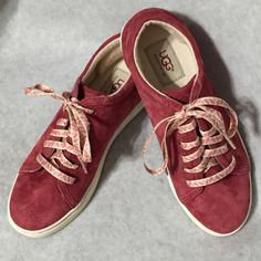"UGG Shoes These UGG shoes are ""samples"" sold by The UGG parent company. Samples of future products being considered for manufacturing. This item does not have a size tag though it matches other size 7 UGGs. No box with this item either. Beautiful cranberry color with pine cone print laces. (NWOT) UGG Shoes"