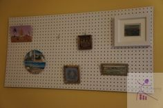 Using a pegboard to display pictures and souvenirs