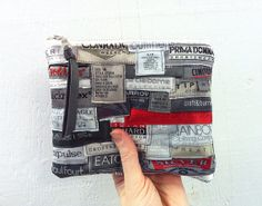 Upcycled Anti-Label Pouch. Made from recycled clothing labels and leather.