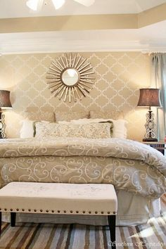 bedroom accent wall and bench at foot of bed, stencil and busy comforter aren't my favorite.