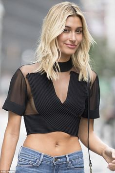 Hard to stomach: Having previously made no secret of her desire to walk down prestigious runway, the model put her best fashion foot forward as she showcased her taut stomach in a sizzling semi-sheer crop top