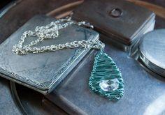 Necklace pendant from the Splinter series, in Minty fresh. By Lotta Losten