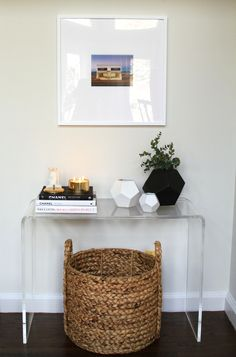 lucite, baskets, plants, books, candles, frames