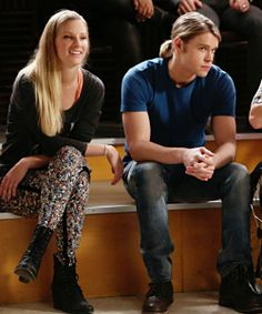 """Brittany and Sam watch a performance in the """"New Directions"""" episode of GLEE."""