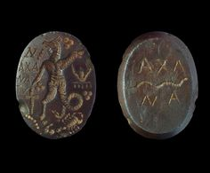 Romano-Egyptian Gnostic Haematite Intaglio 4th-5th century AD. An elliptical intaglio, slightly convex, with image of a hybrid creature (bird`s head, ram`s leg, dog`s head, curled tail) with pellet trefoils, a crab and other items in the field, inscribed text N/AXA/NA/TV`; to the reverse an undulating serpent with `AXA/NA` in seriffed capitals.