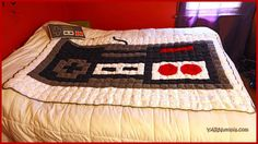 Nintendo NES Controller Pixel Blanket - free crochet pattern and video at YARNutopia by Nadia Fuad.