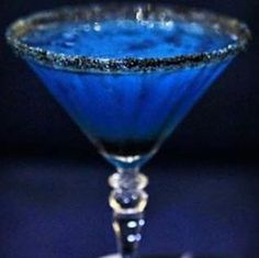 "Sky Witches Brew: 1 oz. Bacardi Dragonberry Rum; 1 oz. Blue Curaçao; 1 oz. Crème de Banana; Juice of one Lime; Black Sugar. Pour ingredients except sugar in shaker with ice, shaking well. Pour into a martini glass rimmed with the black sugar. Got this through FB News Feed (see ""Foodgasms"" [group] October 5, 2013; someone shared it from that group)."