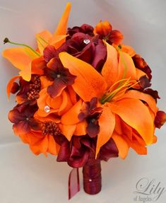 Model: ORBU01  This wedding flower package is made with orange Lilies, orange and burgundy Roses accented with burgundy Hydrangeas and fall color
