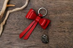 This Keychain is made from genuine Italian leather. If you like a product but you prefer another color of leather contact me and I will tell you if it is possible. All our products are hand-cut and hand stitched without using any machines.