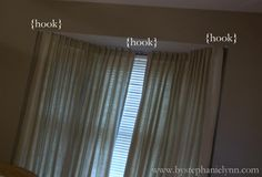 Bay window curtains....I think Greg and I could figure this out...