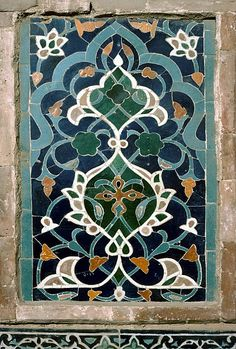 Image TRA 0721 featuring decorated area from the Tillya-Kari Madrassa (Registan complex), in Samarkand, Transoxiana, showing Floriated Arabesque using ceramic tiles, mosaic or pottery.