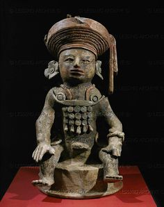 "Top of a censer from the same tomb site as 12-01-03/43. One of 11 censer figures ""watching"" tomb XXXVII-4, perhaps representing ancestors. Wide turban-like headdress, earplugs, pectoral. Clay,paint (7th), 58 cm. From Copan, Structure 26, in front of tomb  Maya,Copan.Honduras"
