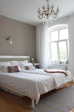 accent wall, light fixture, warm and casual bedding with white walls. Bright, warm, eclectic, all at once. love.