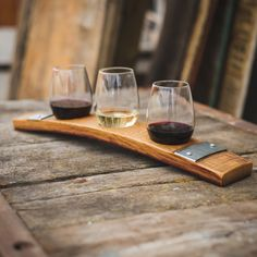 "Our Barrel Stave Wine Flight is a Colorado original. Weve repurposed aged oak wine barrels into unique tasting trays. Here, the barrel stave becomes a flight holding three of your new favorite wines. Weve given you a choice to include the original metal bands to add character to the tray. Each tray is clear coated for years of durable use. Measures approximately 20 long, 3 1/2 wide, and 6"" tall to the top of the tallest glass. This listing includes three 11 3/4 oz stemless wine glasses. Wine…"