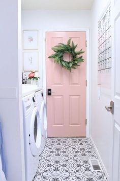 Laundry room design with black and white tile, and a soft pink door