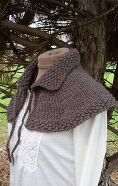 Hand Knit Outlander Highlands Capelet Shoulder Shawl by Shelleden pattern found here:  https://www.etsy.com/listing/204726971/pdf-knitting-pattern-for-highlands?
