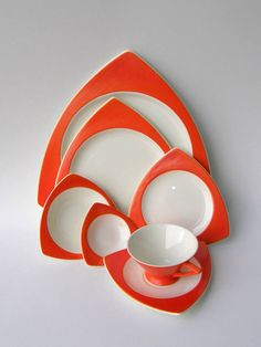 Salem China Streamline & Tricorne Atomic Art Deco Dinnerware Service for 4 in Mandarin Orange (aka Mandarin Red): a perfect gift for lovers of vintage & Mid Century tableware, these Salem China shapes are so retro fabulous, its featured in a Los Angeles County Museum of Art collection! Atomic, architectural, pure retro fabulosity, Salem Chinas Streamline & Tricorne shapes smashed into the well-ordered design world of line and curve with their Jetson-like conical cups sharply angul...