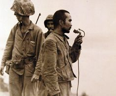 Battle of Saipan, Jun-Jul 1944. Japanese soldiers taken prisoner after being persuaded to come out of caves near Marpi Point on Saipan, Japanese soldier using loud speaker asking his friends to come out, July 12, 1944. Photographed by USS Indianapolis (CA 35) photographer. U.S. Navy photograph, now in the collections of the National Archives.