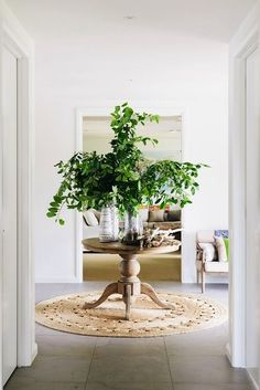 Great and beautiful feng shui way to remedy the direct door alignment. More feng shui door tips. Decor, Interior, Interior Inspiration, Home, Entry Foyer, Jute Round Rug, Round Entry Table, Foyer Decorating, Decal Wall Art