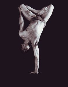 One hand lotus hand stand - Dharma Mittra.