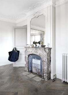 Marble fireplace in a Parisien apartment with beautiful bones. Birgitta Wolfgang Drejer.