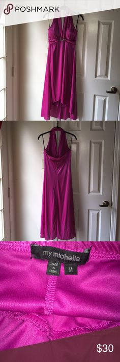 Dress Fuchsia halter too high low dress with a silver brooch attached midway. Never been worn and will sure to get you noticed. Medium in size and easy to accessorize. Can be worn for any occasion. My Michelle Dresses High Low #broocheswithdresses