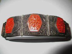 Vintage antique Oriental Chinese Import panel bracelet with carved red floral pattern Cinnabar. Dark silver tone metal. Filigree design. Mixed metal,