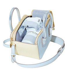 STELLA MCCARTNEY X CANON Linda bag and EOS camera. Canon EOS 100D White camera. White, the world's smallest DSLR.