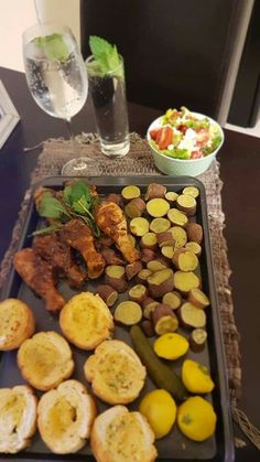 Soft vegetables chicken and french loaves side salad sparkling mint water