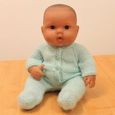 I knit this little suit for the baby doll at my granddaughter's Strong Start preschool. There are 3 sizes in the pattern, but all of them would normally fit the taller, skinnier child like propor. Knitting Dolls Clothes, Crochet Doll Clothes, Doll Clothes Patterns, Doll Patterns, Knitting Patterns, Boy Baby Doll, Bitty Baby Clothes, Pixie Outfit, Baby Knitting