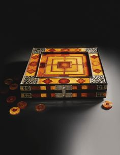 A game board and pieces said to have been carried by King Charles to his execution in 1649 recently sold at auction for just over £600,000. The folding board includes surfaces to play Chess, Nine Men's Morris, and Backgammon. It's constructed of amber with gold foil and silver hardware, and is inscribed with the titles of episodes from Ovid's Metamorphosis. (alternate photo)