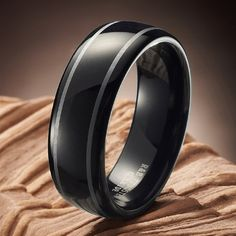 This solid style will add a masculine trendy touch to your look, Featuring a simple yet beautiful stripes design in strong black. Can be a great wedding band or engagement ring!