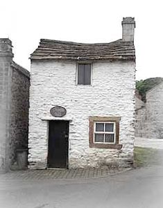 Thimble Hall, Youlgreave, Peak District, England is the tiniest detached house in the world, measuring 11 x 10ft 10 x 3ft and 12 x 12ft high. In the past it has been used as a Butchers, a Cobblers, and antique shop and about 100 years ago housed a family of 8 even though it only had two rooms and connected by a ladder!